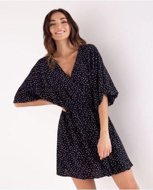 Oferta de Vestido corto para mujer negro manga corta con lunares estampados por 179900€